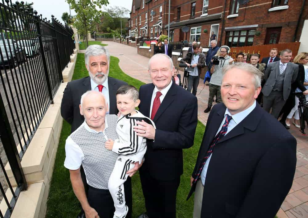 Late Deputy First Minister Martin McGuinness with Housing Executive Chief Clark Bailie local residents and IFI Board Member Allen McAdam all pictured at the transformation of an interface barrier on the Crumlin Road in North Belfast.
